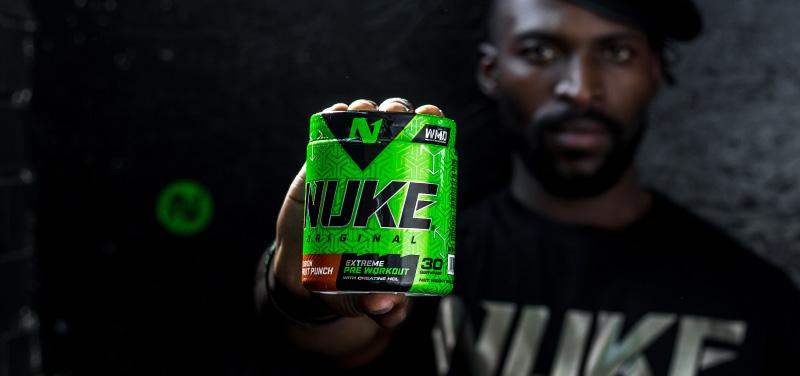 Nutritech athlete, Enoch, holding a tub of Nuke
